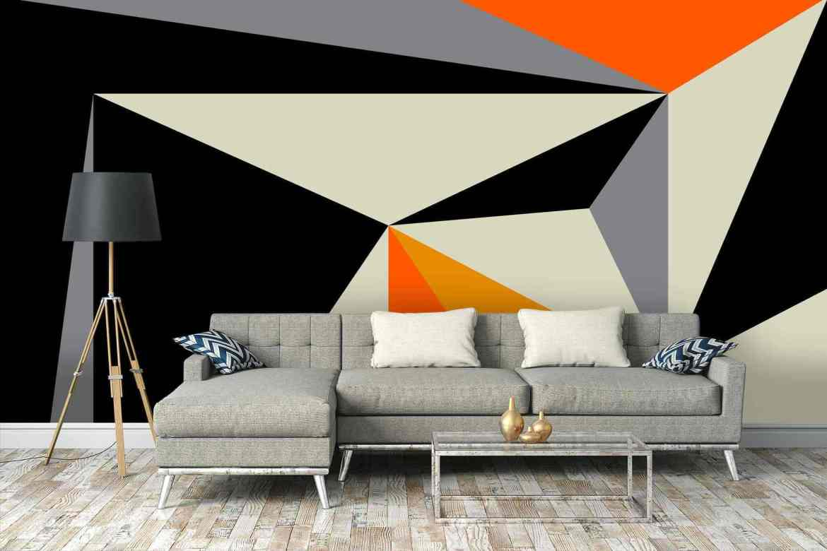 A sofa with a geometric wallpaper on the background.