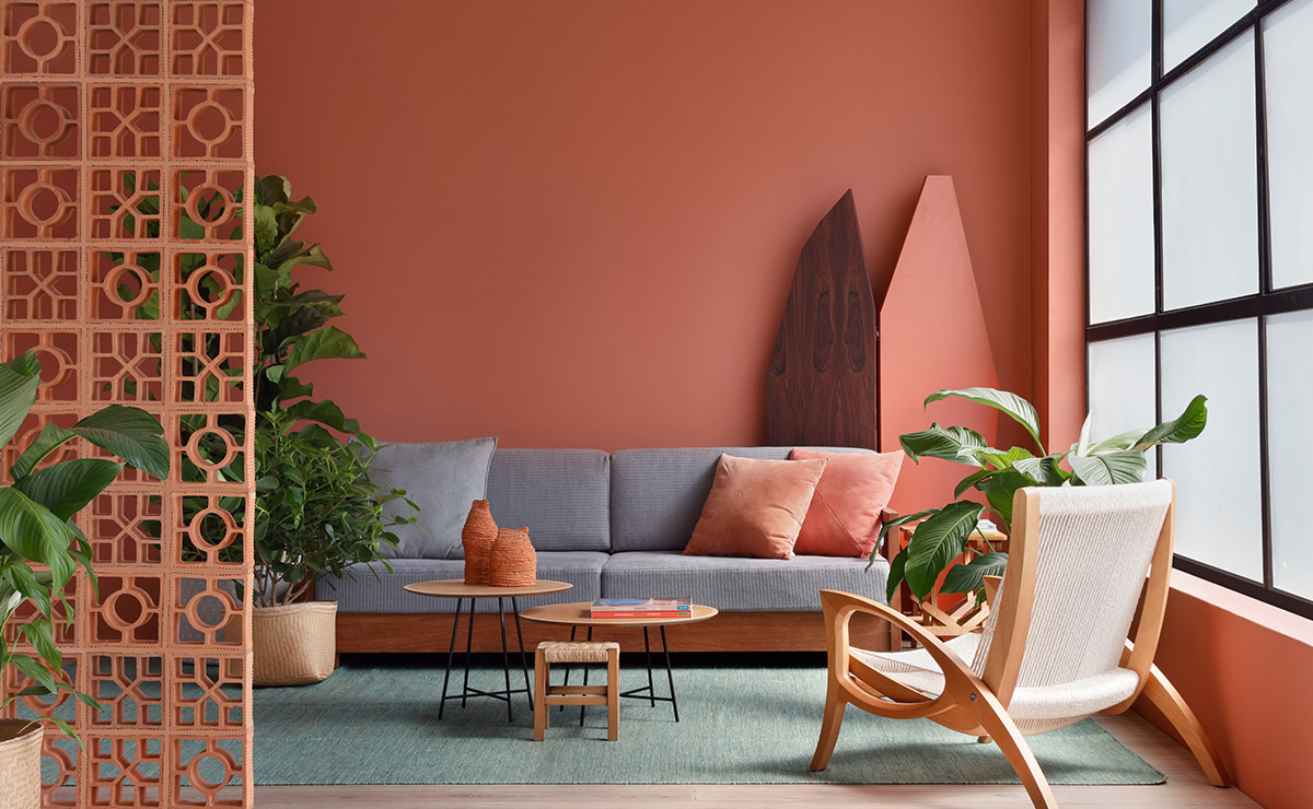A living room based on the living coral interior winter trend.