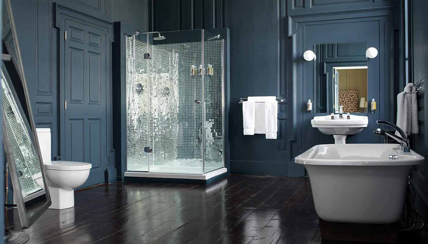 a bathroom with darker blue walls of Blue bathroom inspirations for your design project