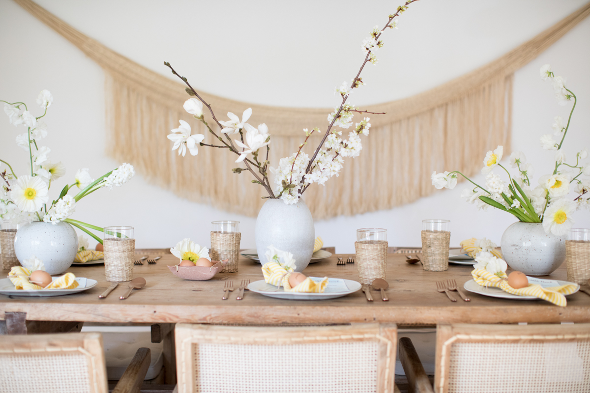 A table with flowers by easter table setting ideas