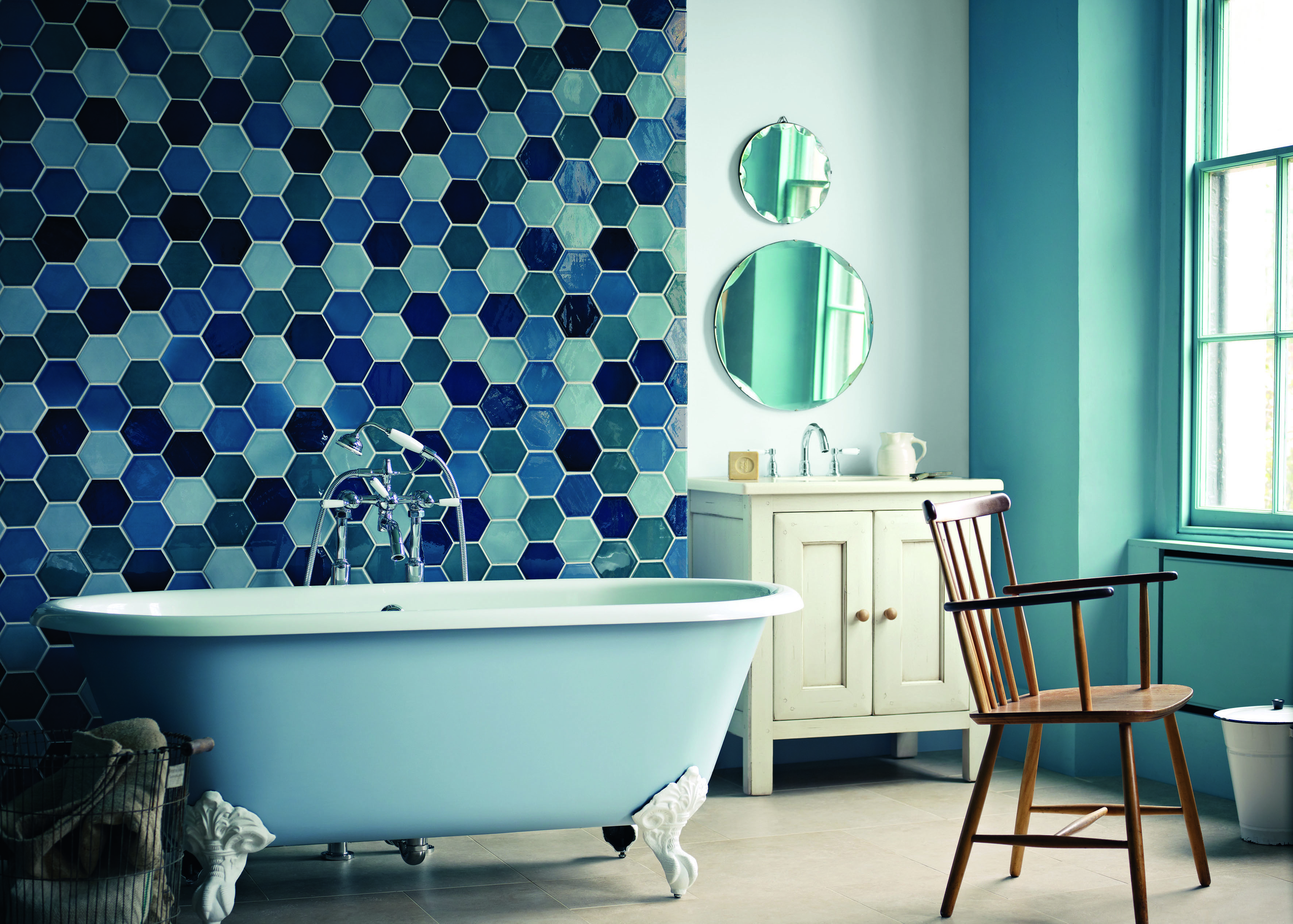 A bathroom with blue tiles of Blue bathroom inspirations for your design project