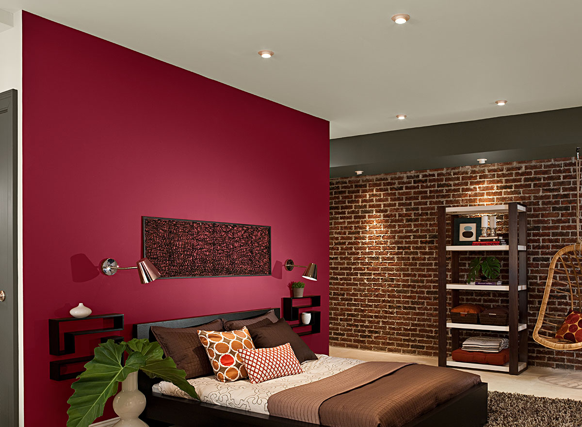 red brick wall in a bedroom of The Color red article