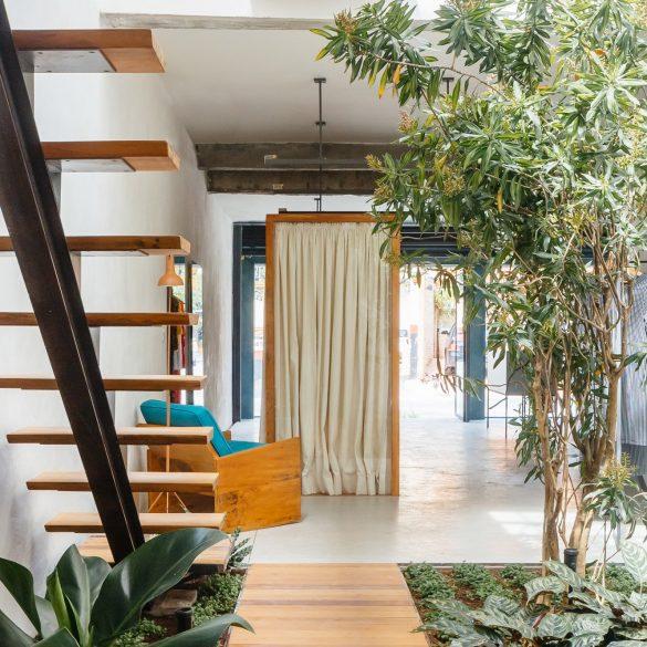 Vão Arquitetura designed a boutique around a luxuriant indoor garden